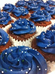 Yummy triple chocolate cupcakes with royal blue frosting