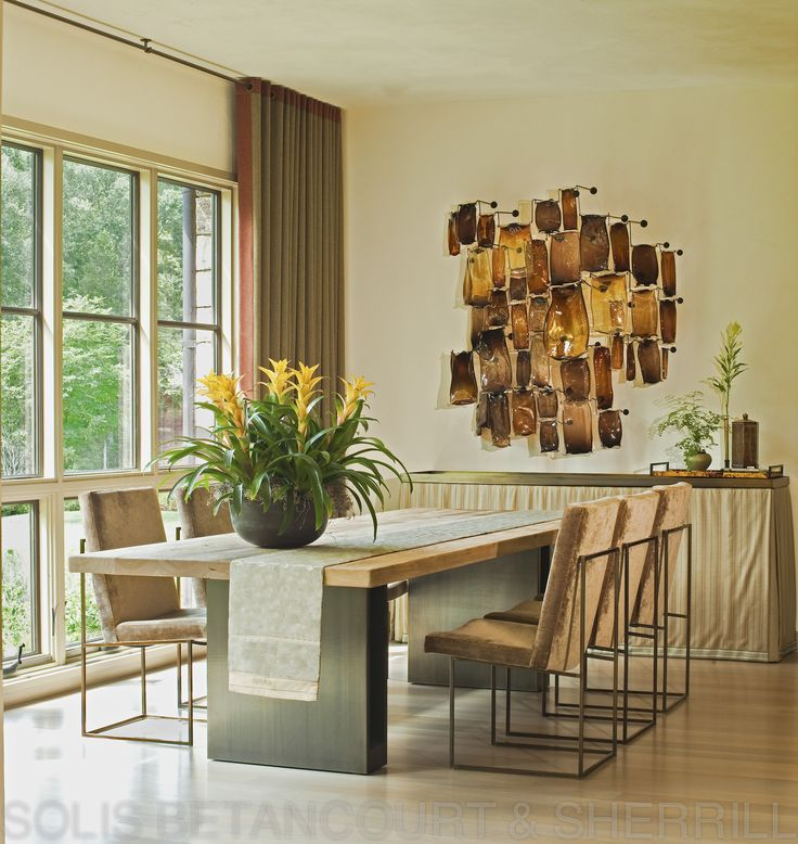 A sleek and contemporary dining room by solis betancourt for Sleek dining room furniture
