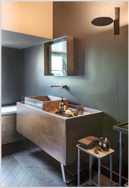The OK pendant lamp adds a touch of whimsy and contemporary flavor to this minimalist bathroom with a dark neutral color scheme and a top mount sink.