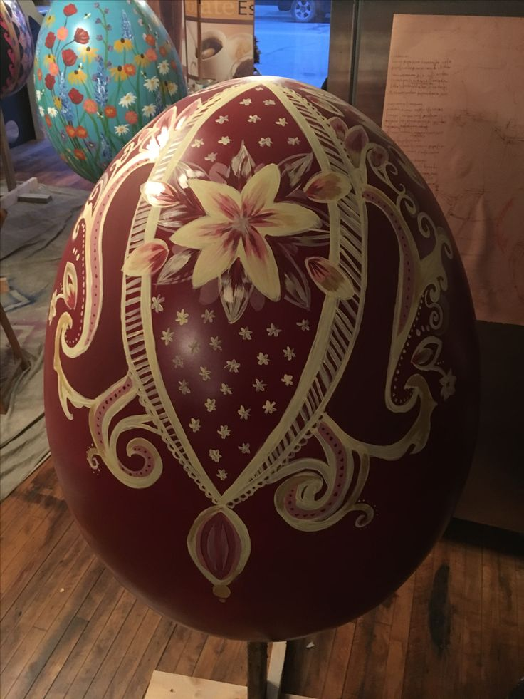 """""""Eggsquisite"""" giant egg painted by Franciscan University student Marianna Schmiesing. Located at Bookmarx Used Bookstore"""
