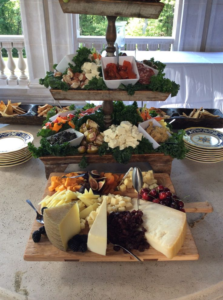 wonderful array of appetizers displayed in a wooden tiered server.