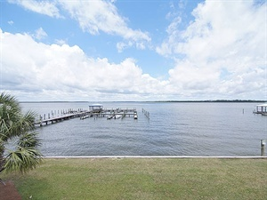 Enjoy a peaceful bay view in Orange Beach, AL. The 2BR/2.5BA townhome-style Bayview 27 offers a spacious covered deck, an outdoor pool and a pier. Sleep as many as 6 people with a king, queen, daybed and sleeper chair. http://www.meyerre.com/property/Bayview_27 #beach #vacation #OrangeBeach #GulfShores