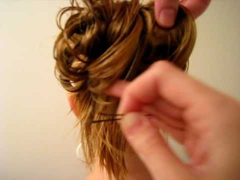 Messy Bun bobby pin trick. Love the way she does this messy bun. Simple and quick but still looks better than some or even most messy bun looks.
