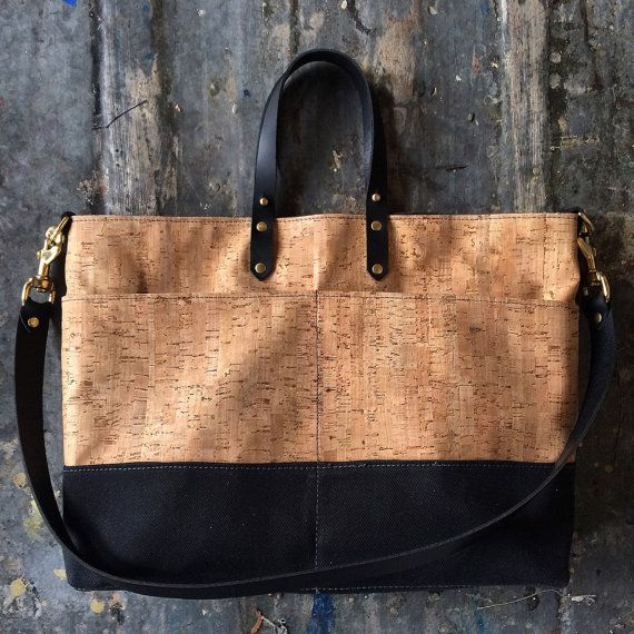 Constructed with durable, waterproof cork fabric and a heavyweight waxed cotton base. Twill lining with two interior pocket Solid brass hardware