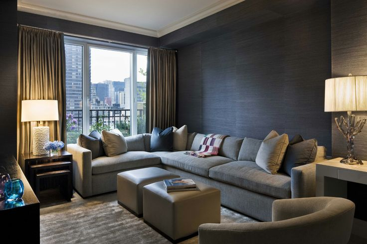 dark grasscloth + rich textures in sectional space by Grade