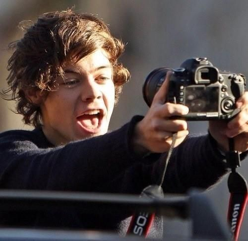 The whole of one direction clearly love selfies. Here is Harry getting in on the action.