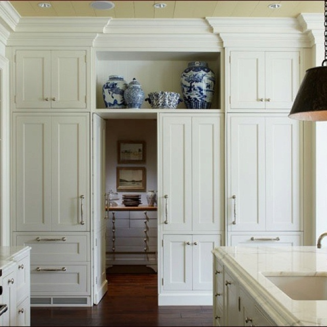 Hidden pantry door home ideas pinterest i love for Tall kitchen cabinets