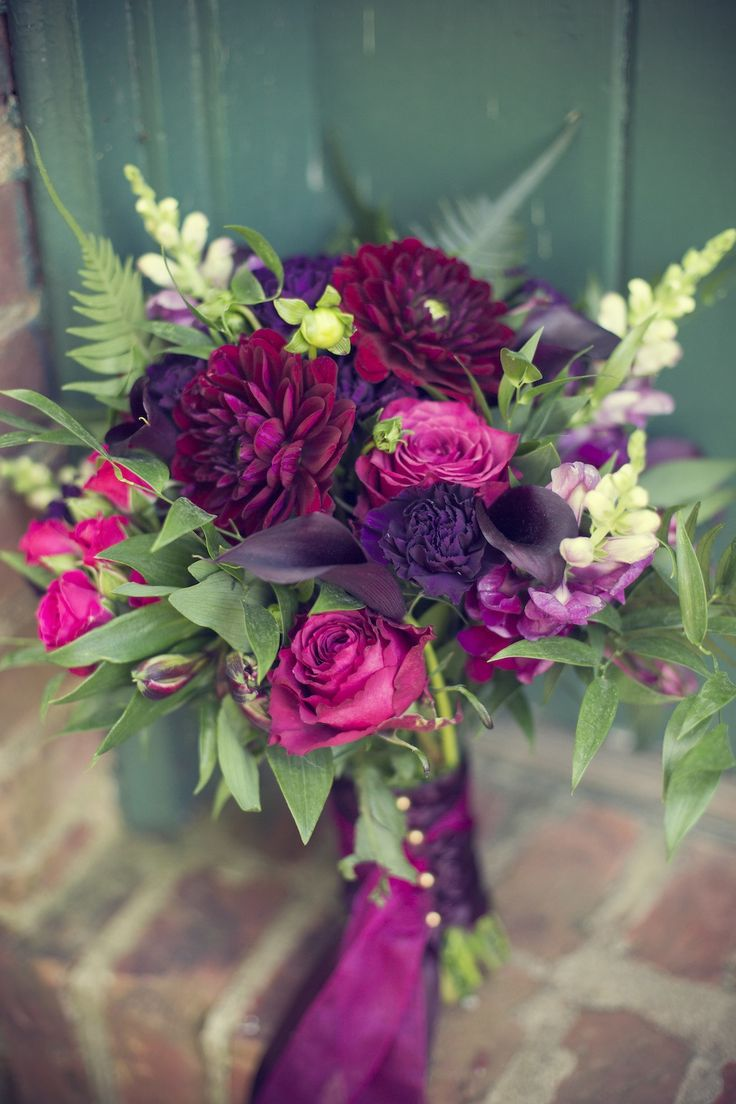 Love all the rich colors in this red, purple, hot pink, and burgundy wedding flower bouquet | Photograph by Pamela Lepold Photography