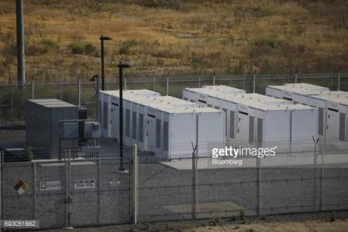 06-14 Tesla Inc. Powerpacks and inverters stand behind a fence... #mira: 06-14 Tesla Inc. Powerpacks and inverters stand behind a… #mira