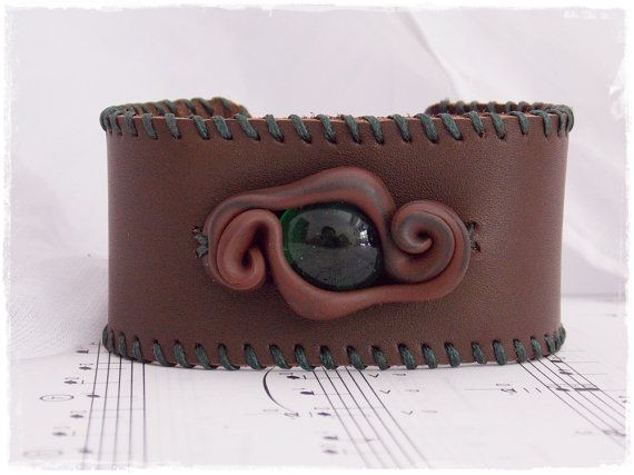 Hey, I found this really awesome Etsy listing at https://www.etsy.com/listing/163086190/elven-leather-cuff-dragon-mens-wristband