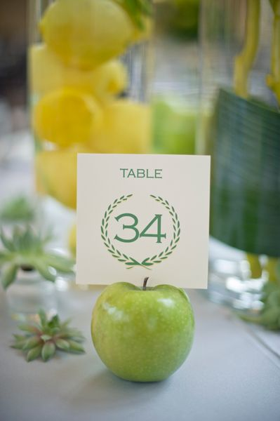 Love this Apple table number holder, perfect with the lemon centerpiece in the background