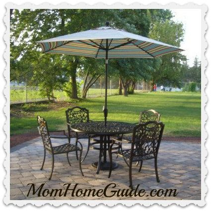 Beautiful Patio Table And Chairs With Umbrella On Paver Pation