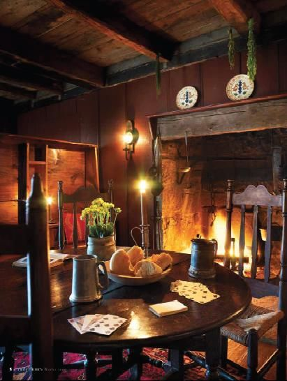 I love the fireplace. I would have a pot of soup or stew simmering on a crane. The candlelight adds to the cozy look. My dream............