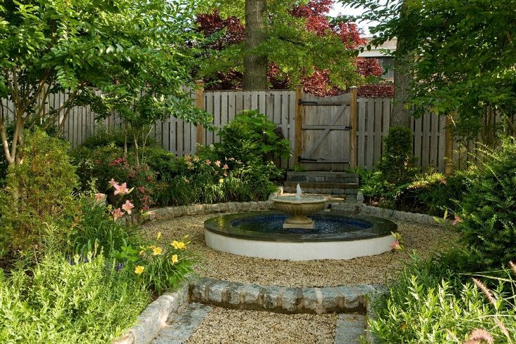 Crushed Glass Landscaping With Stone Water Fountain