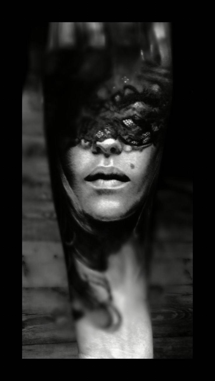 Realistic black grey tattoo by Lilian Dekkers