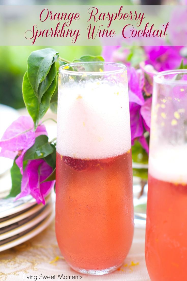 Orange raspberry sparkling wine cocktail: the ultimate summer cocktail! Combine cointreau with raspberry sorbet, fresh raspberries  in a bubbly delicious drink.  Perfect summer recipe