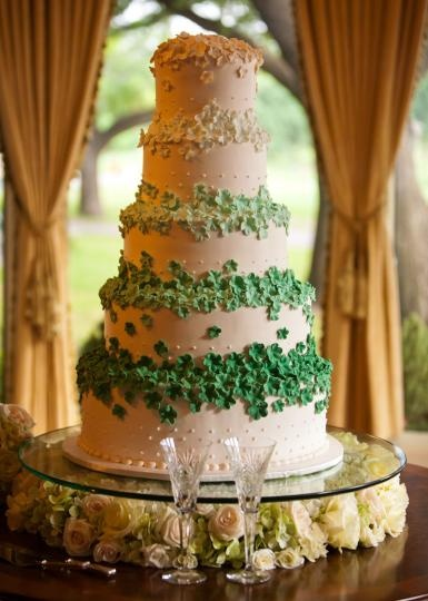 Five tiers of green and white wedding cake fabulousness with ombre flowers! Photo by Carter Rose of f8 Studio