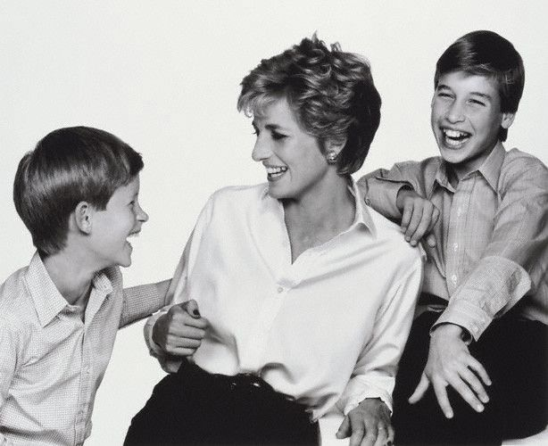 With her boys. Seems so relaxed here.