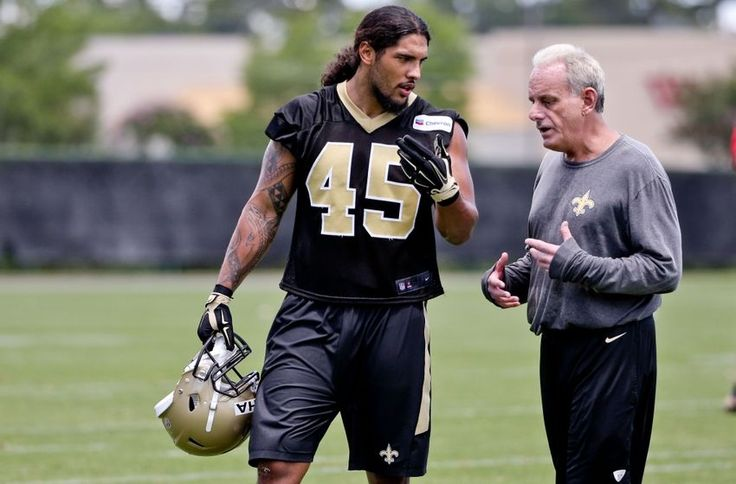May 28, 2015; New Orleans, LA, USA; New Orleans Saints rookie linebacker Hau'oli Kikaha and LB coach Joe Vitt.