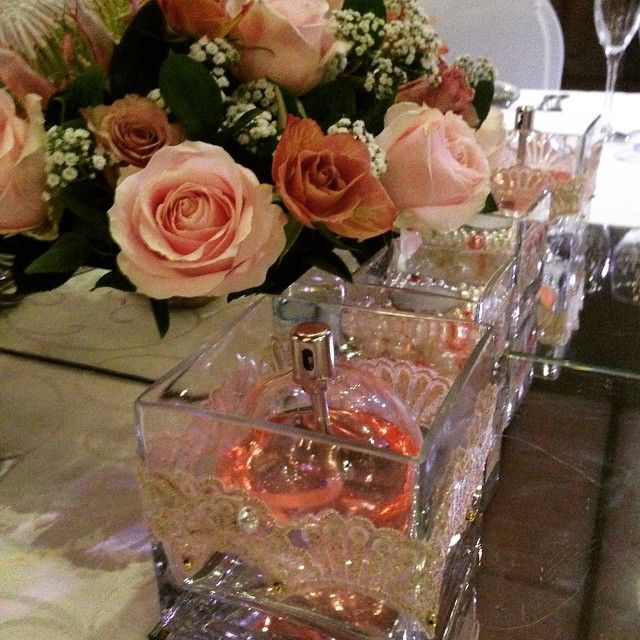 Pink perfume centre pieces #ThabaWeddings #CelebratingLife