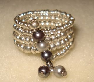 Memory wire rings can also be fun to make, and they are even quicker than bracelets!  I like to use metallic seed beads to surround focal be...