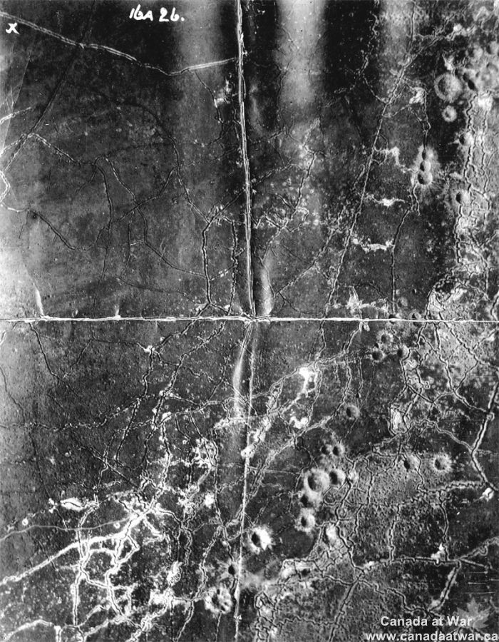Vimy Ridge from the Air - This aerial photograph illustrates the major trench lines around an unknown sector on Vimy Ridge. The large craters, some ten to 15 metres deep, were made from mine explosions set off by Canadian engineers prior to and during the assault of 9 April 1917. Mines could create great confusion and blow huge gaps in an enemy's defences, but they were also significant obstacles for advancing troops.