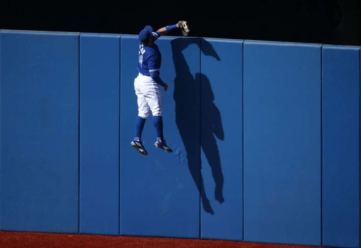 Climbing the wall -  Kevin Pillar #11 of the Toronto Blue Jays climbs the wall but cannot get to a solo home run hit by Kevin Kiermaier #39 of the Tampa Bay Rays in the fourth inning during MLB game action on Sept. 26 at Rogers Centre in Toronto, Canada. - © Tom Szczerbowski/Getty Images