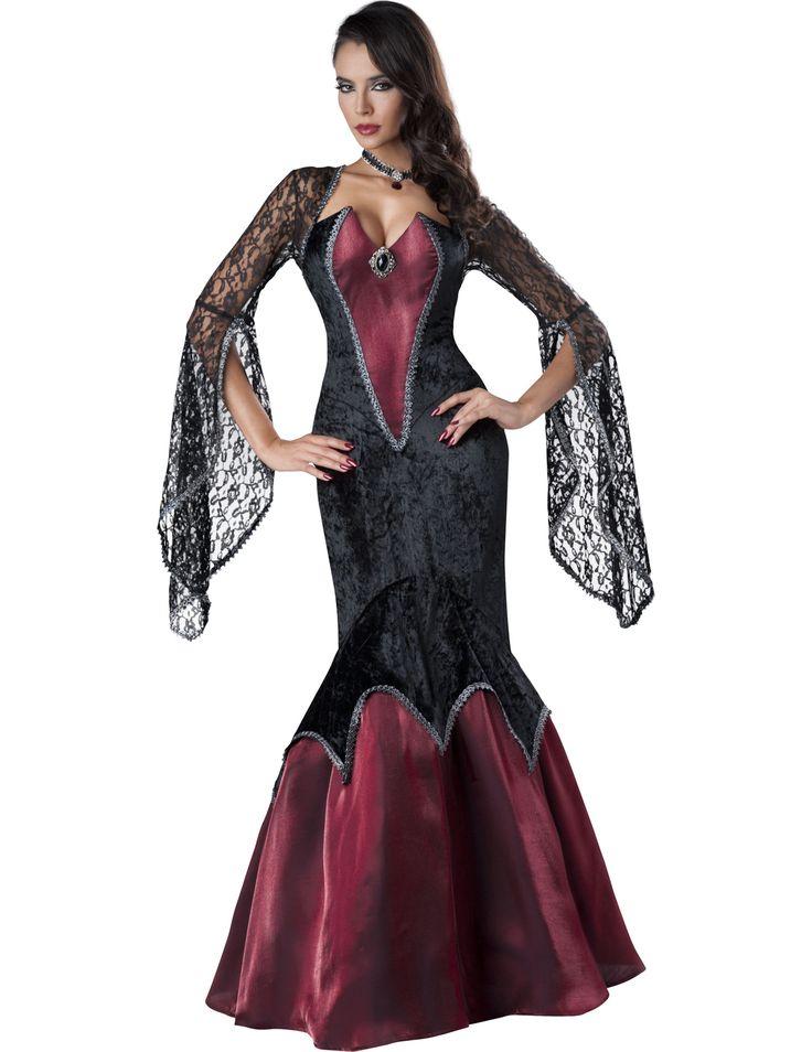 Déguisement Beauté Perçante pour femme - Premium : Ce déguisement pour adultes est composé d'une robe et d'une broche (ras-de-cou non inclus).La robe est longue et majoritairement noire en velours, tandis que les parties en...