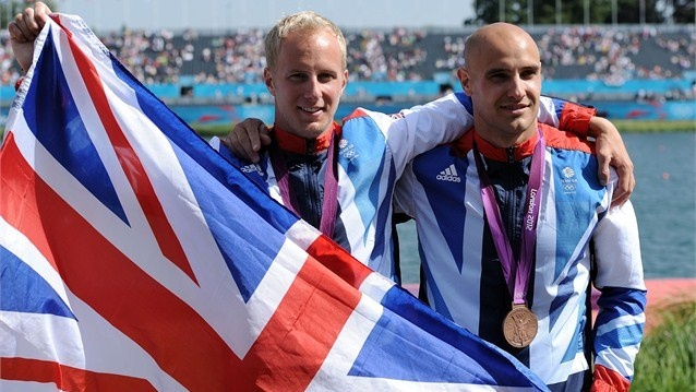Bronze medal winners Liam Heath and Jon Schofield of Great Britain celebrate after the Victory Ceremony for the men's Kayak Double (K2) 200m Canoe Sprint on Day 15