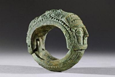 MESOPOTAMIAN BRONZE BRACELET WITH FEMALE HEADS      DATE: 1200 BC - 8th Century BC  CULTURE: Mesopotamian