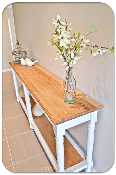 I so want a table like this for my upstairs hallway. Thinking of tearing apart my antique expanding kitchen table and getting Andrew to build table like this . . . .