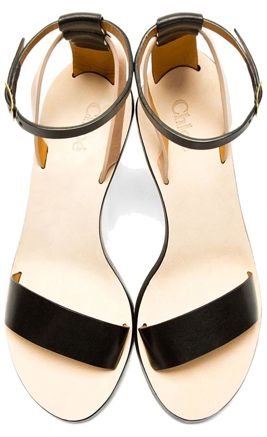 Buffed leather wedge sandals in black and nude. Round open toe. Adjustable ankle strap with pin-buckle closure. Designed by Chloe. http://zocko.it/LD4Nm