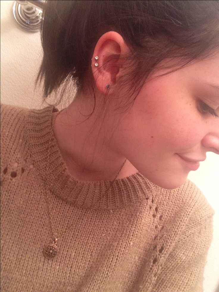 double auricle/midway cartilage piercing
