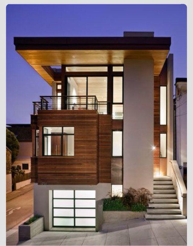 Modern- cedar siding, black windows, cream cement board