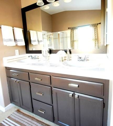 Painted bathroom vanity.  I like the grey with chrome hardware. This would perk up my bathroom.