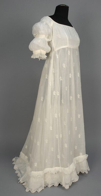 White cotton muslin gown with broderie anglaise decoration and double-puffed sleeves, probably American, 1799-1810.