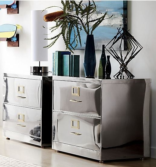 steel the show. File away the notion that office furniture can't be fancy. Hand-polished stainless steel cabinet shines chic, offering ample space for papers and supplies. Iron handles with brass-finished bars; iron drawers accommodate letter or legal-sized folders.