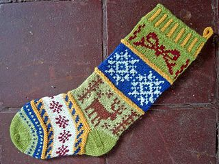 """Corrugated ribbing, fair isle and Scandivanian designs of your choice. Select your own motifs (charts) and create a unique Christmas stocking for your family, pet or friends. Knit in the round in worsted weight yarns, this stocking will surely become a treasured heirloom. The """"afterthought"""" heel is worked last. Let your imagination and/or colors run wild."""