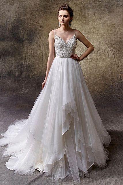 Mooie jurk met speelse rok van #Enzoani