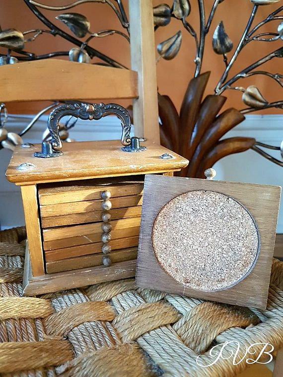 Vintage wooden coasters set in a wood case with metallic