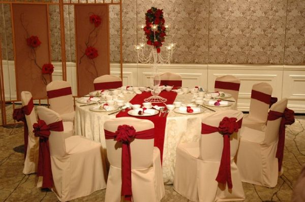 Love this style of chair decoration. Can use any color for the bow. Make sure to match table runner to bows.
