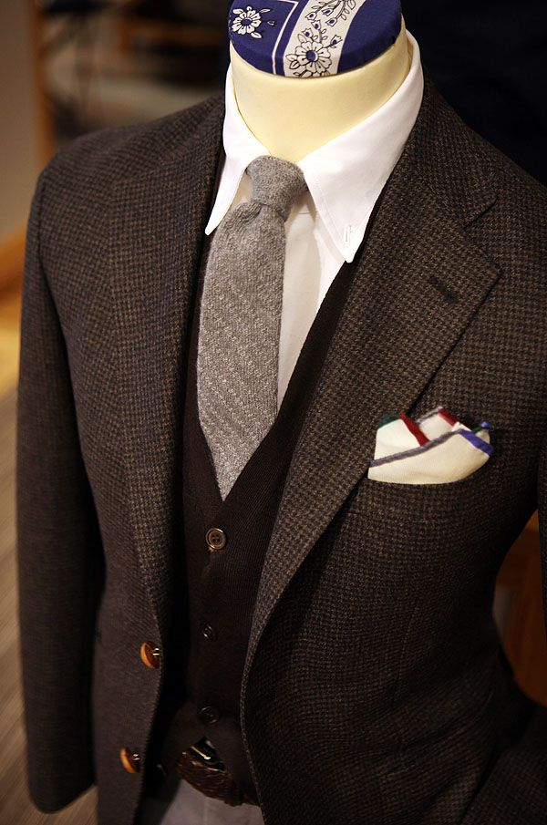dark gray tweed jacket. brown waistcoat. ash gray tie. white oxford. white pocket square w/trim. gray pants. sophisticated. subdued. style.