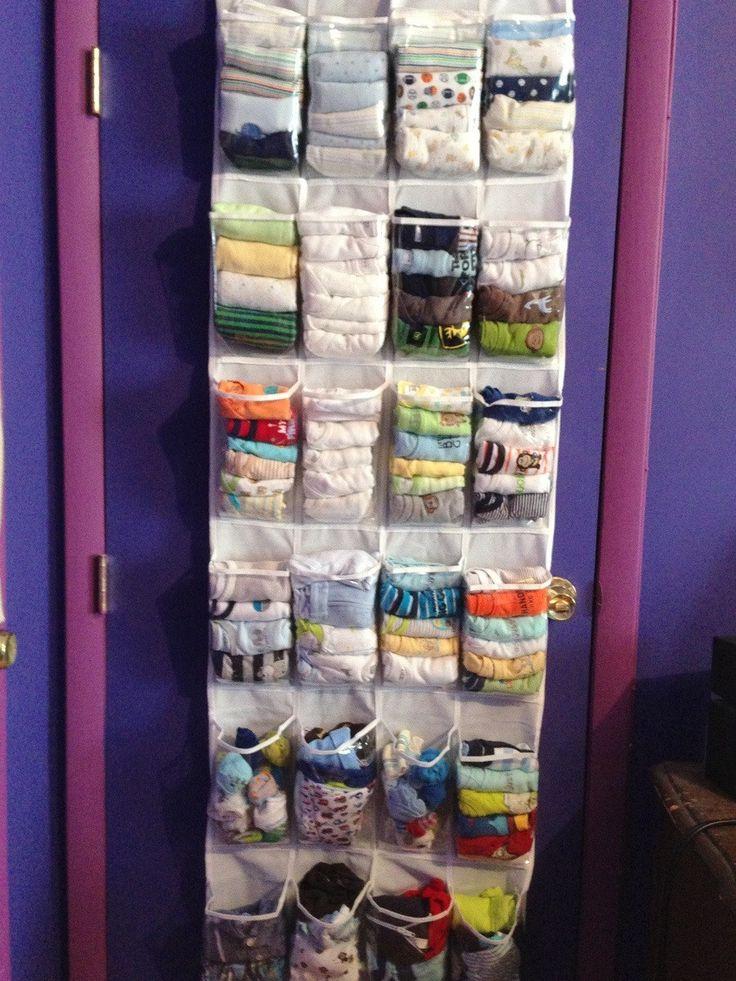 Baby clothes storage in hanging shoe holder on back of door (via reddit r/babybumps)