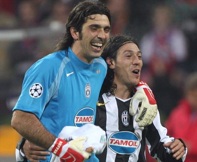 Buffon shares a smile with Mauro Camoranesi after Juventus beat Bayern Munich