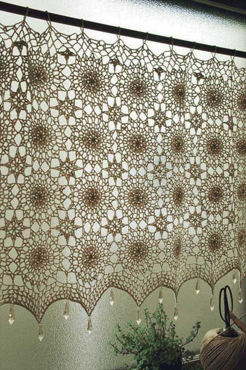 A beautiful crochet cafe curtain. I like the crystal drops along the bottom edge.                                                                                                                                                                                 More