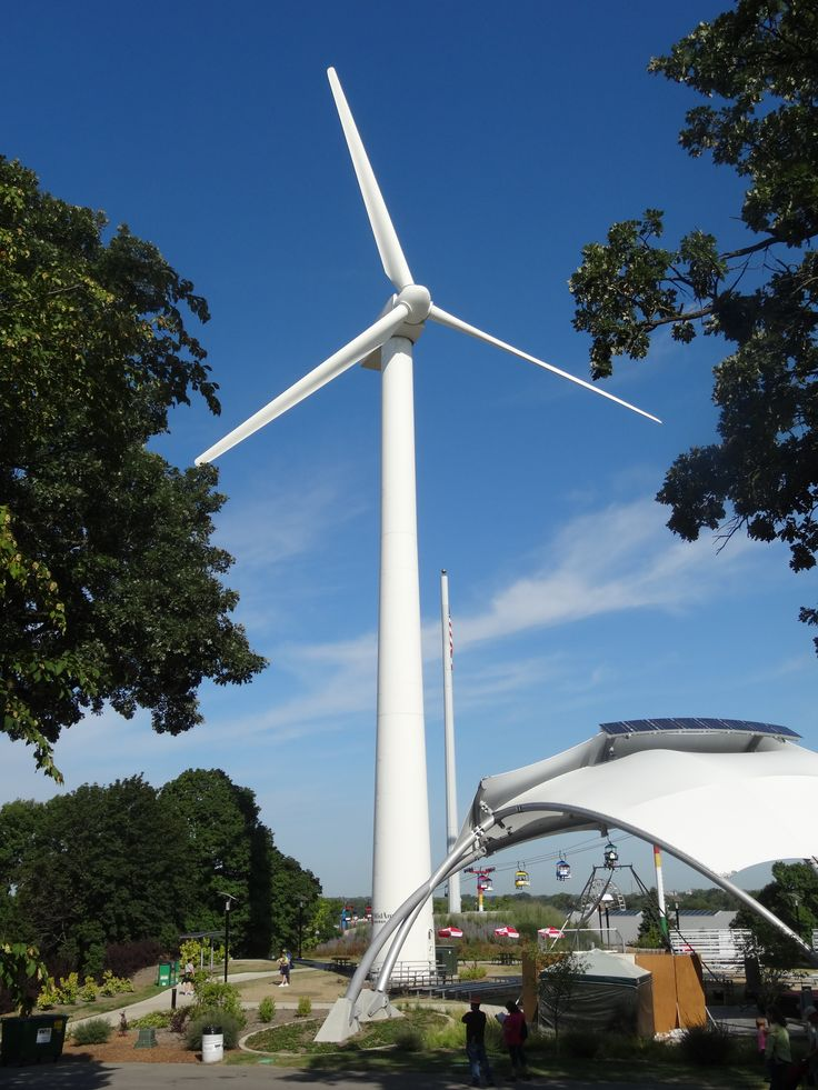 Wind turbine with Sky Glider ride visible
