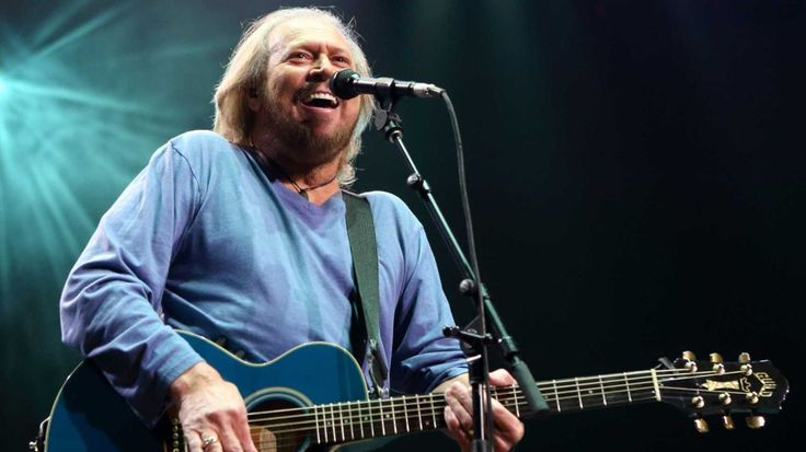 "Barry Gibb's ""Mythology"" tour was never supposed to happen. The lone surviving member of the Bee Gees was considering retirement after the death of his"