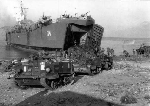 British Army Universal / Bren Gun Carriers roll out of an LST, during Operation Avalanche, the Allied landing at Salerno, Italy, 9 September 1943.