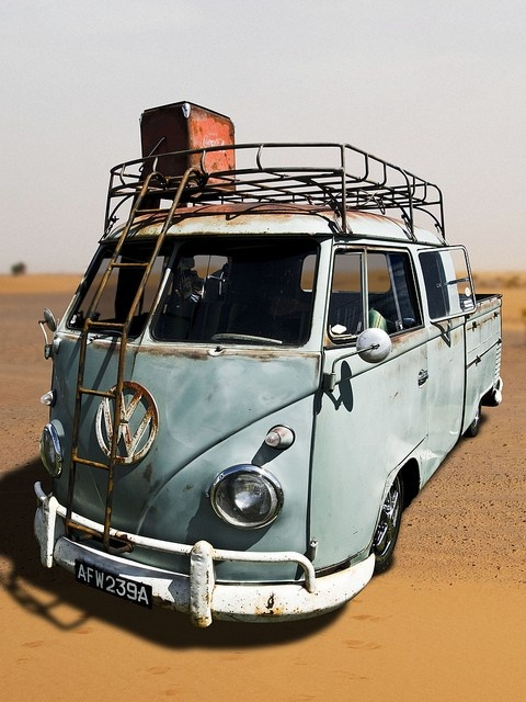 VW split crew cab pickup. Ladder up the front screen.