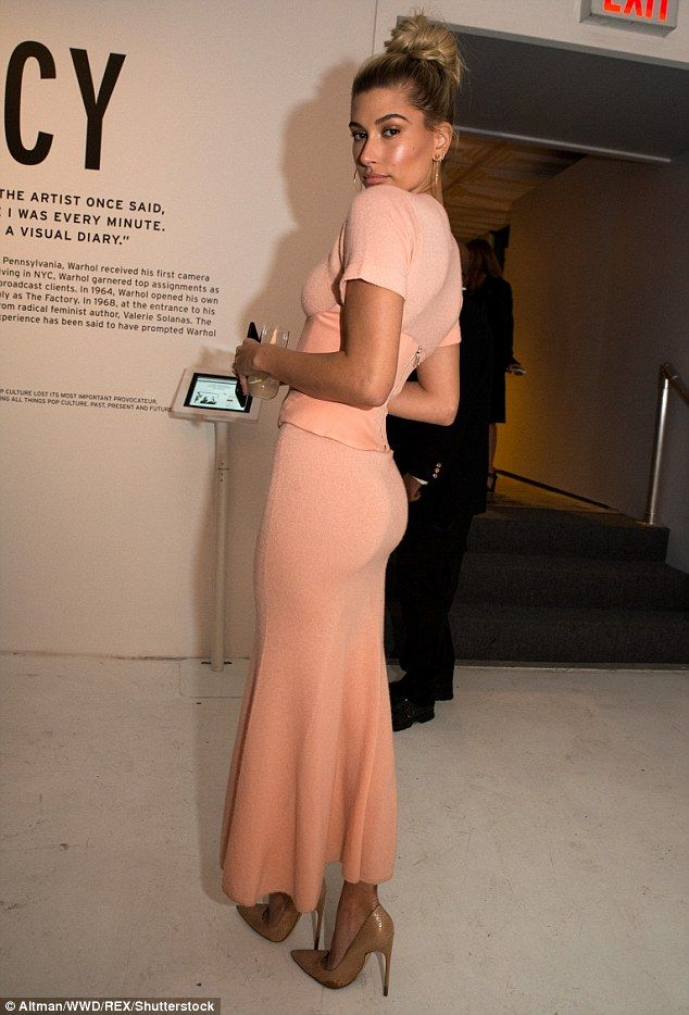 A vision! Hailey, 20, put her perky backside on display in the clingy dress...